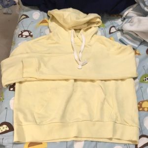 yellow hoodie with white drawstrings